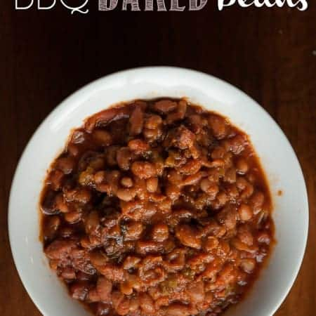 Homemade BBQ baked beans loaded with flavor and, most importantly, bacon cannot be beat for any summer outdoor barbecue with friends or family.