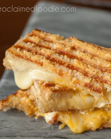 This crunchy and gooey triple threat grilled cheese uses gouda and sharp cheddar melted in between two parmesan encrusted grilled pieces of sourdough.