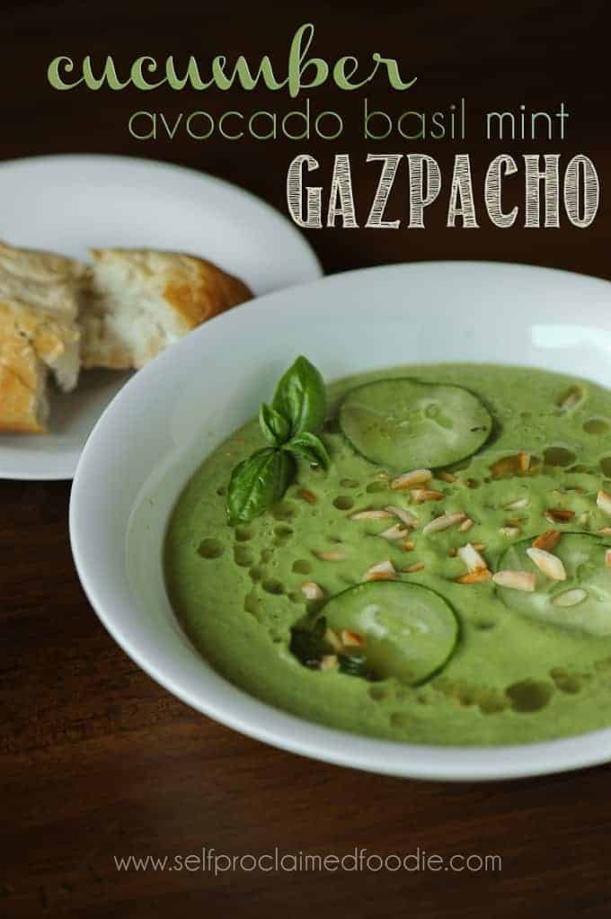 a bowl of cucumber avocado gazpacho with bread on the side