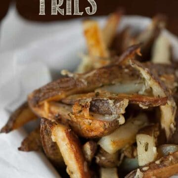 a pile of homemade rosemary garlic baked fries
