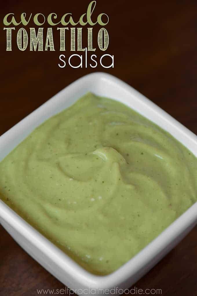 square white bowl of homemade avocado tomatillo salsa