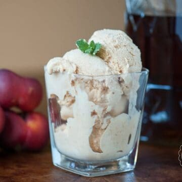 This homemade Bourbon Nectarine Ice Cream is the perfect blend between sweet fresh fruit and creamy vanilla bean ice cream with a smooth bourbon finish.