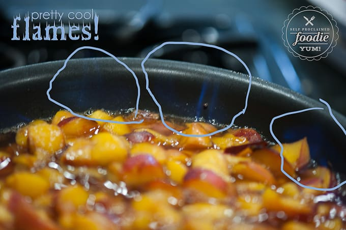 nectarines cooking with bourbon whisky with flames