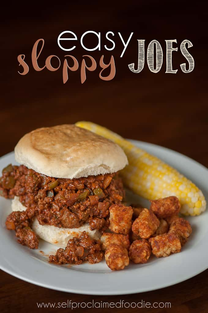homemade sloppy joe on plate with tater tots and corn