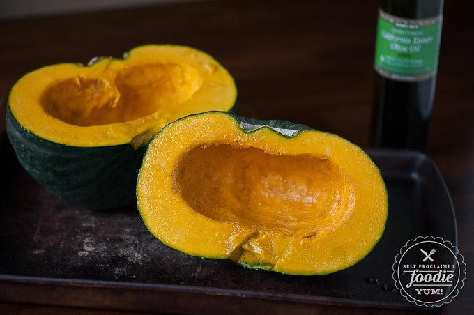 whole winter squash cut in half and covered in olive oil