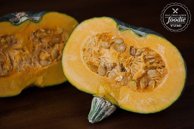 buttercup squash cut in half with seeds in preparation for roasting in oven
