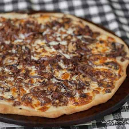 Homemade Sausage Onion and Mushroom Pizza can be a delicious appetizer or eaten alone for a full meal. Bursting with flavor, you're going to love this pizza.