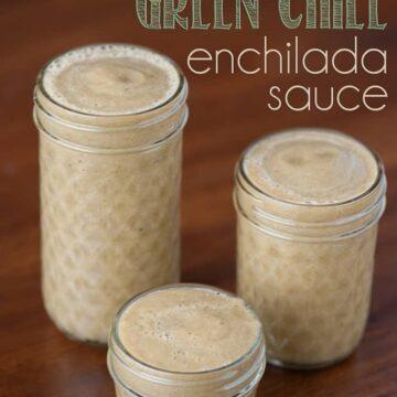 three mason jars filled with homemade green chile enchilada sauce