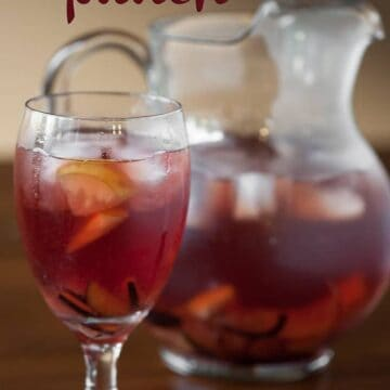 a glass and pitcher of fall inspired sangria