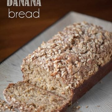 a loaf of pumpkin banana bread with walnut streusel topping