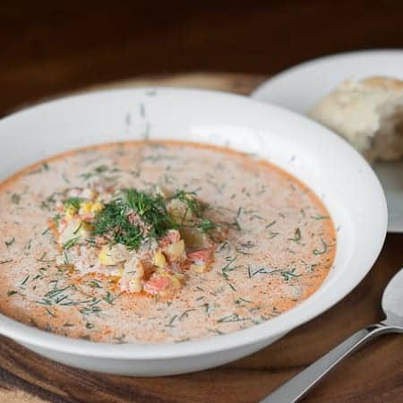 Enjoy a hearty and tasty bowl of homemade Salmon Chowder made with fresh corn, potato, lots of fresh dill, and a touch of cream. Delicious!