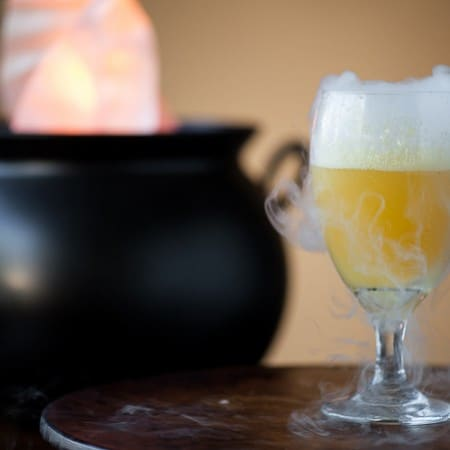 This sweet and sparkling Halloween Witches' Brew made with fruit juice is a fun party drink for all ages and can easily be made into an adult cocktail too.