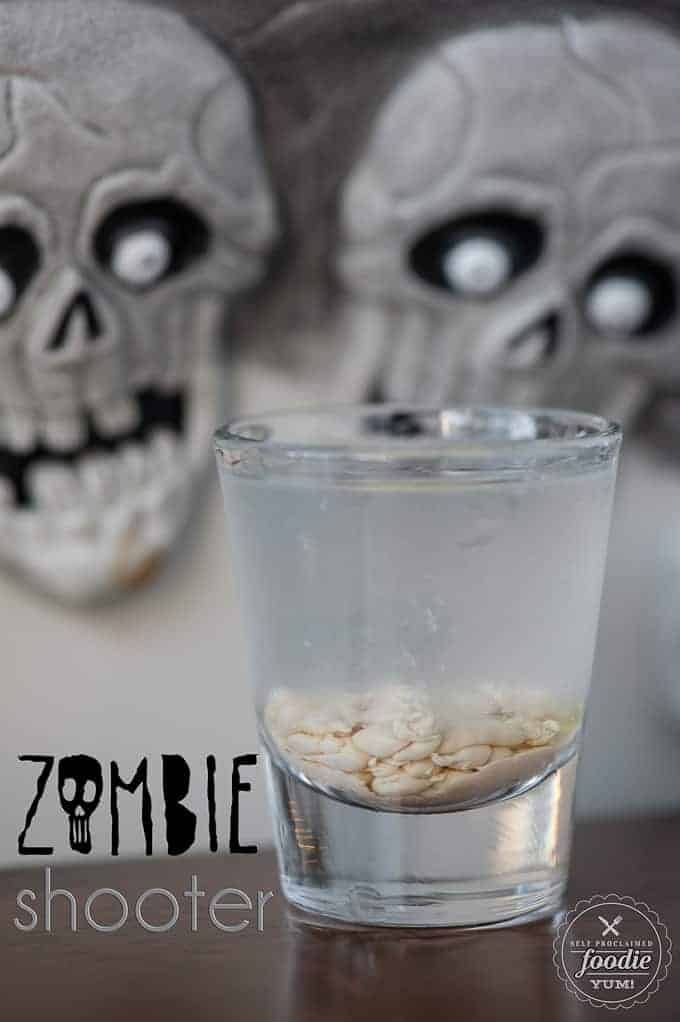 a Halloween cocktail in shot glass that looks like a brain