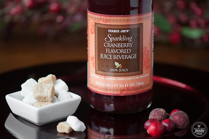 bottle of sparkling cranberry juice with sugar cubes