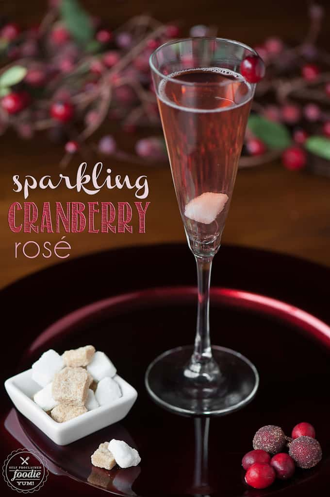 champagne flute with sparkling cranberry rose cocktail with sugar cubes