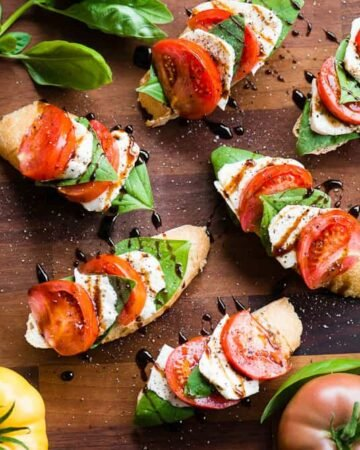 Caprese bruschetta with tomatoes on the side