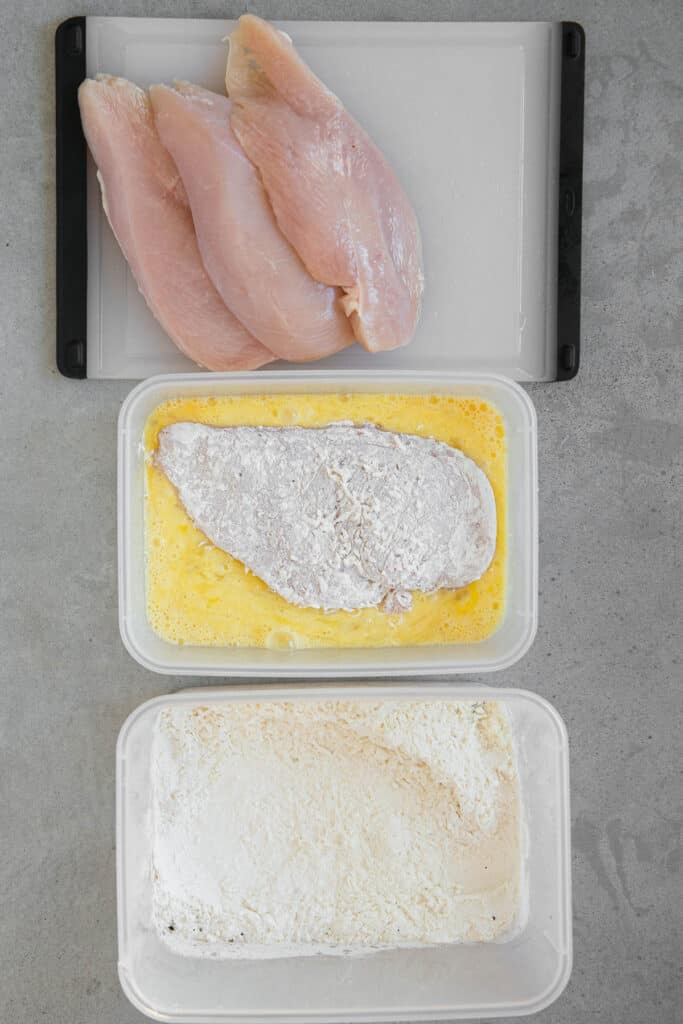 putting breaded chicken in egg wash