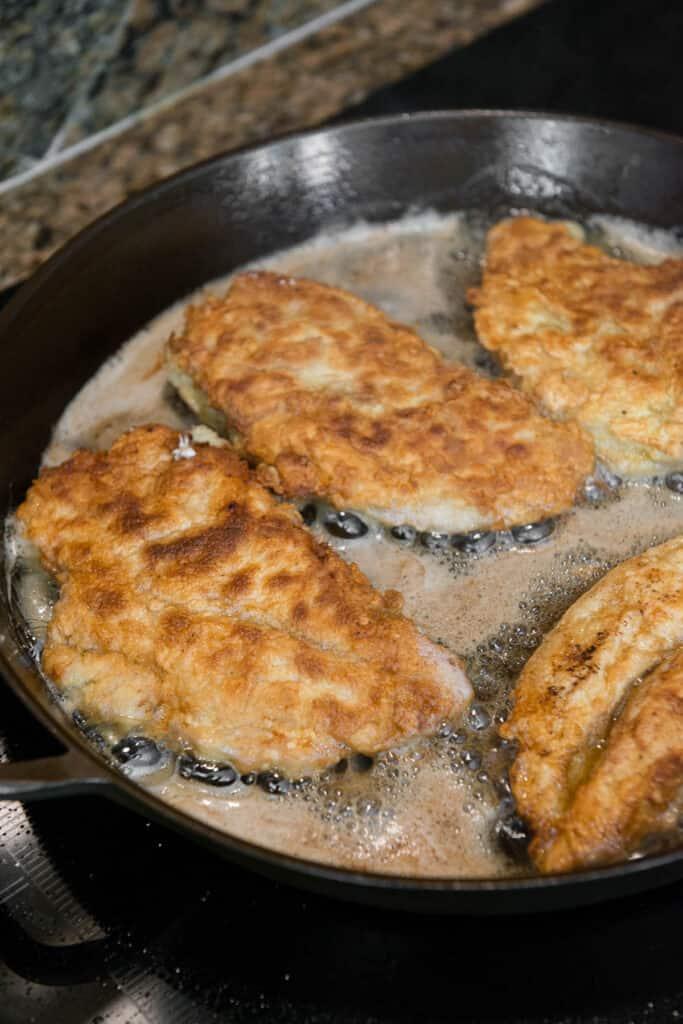 frying chicken breasts in pan