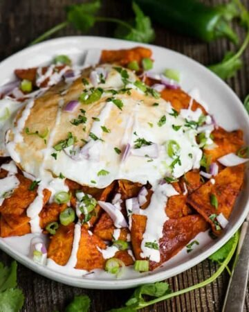 plate of traditional Chilaquiles with eggs