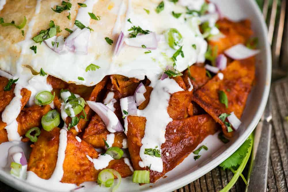 recipe for authentic Chilaquiles with red enchilada sauce and eggs