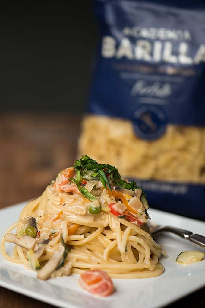 Eat the rainbow with this creamy yet quick and easy to make Dozen Veggie Pasta Primavera! The texture of the pasta and flavor in the sauce is incredible!!!