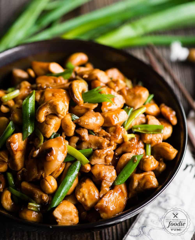 Cashew Chicken in bowl with chopsticks