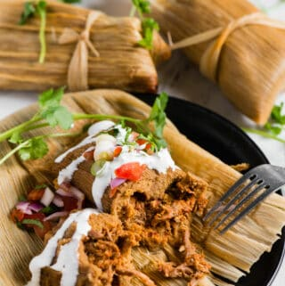 homemade authentic pork tamales wrapped in corn husks