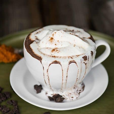 Pumpkin Spice Hot Chocolate with real pumpkin puree is a classic warm fall drink. Make a single cup for you or a batch in the slow cooker for a crowd!