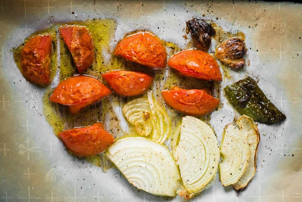 roasted tomatoes, onions, jalapeno and garlic for salsa roja recipe