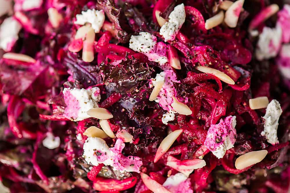 A close up of beet and kale salad