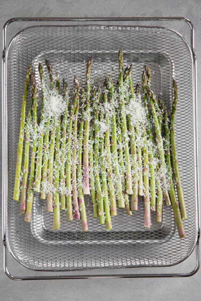 asparagus with parmesan in air fryer basket