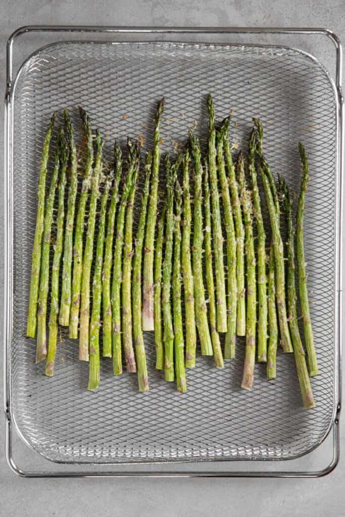 air fried asparagus in metal basket