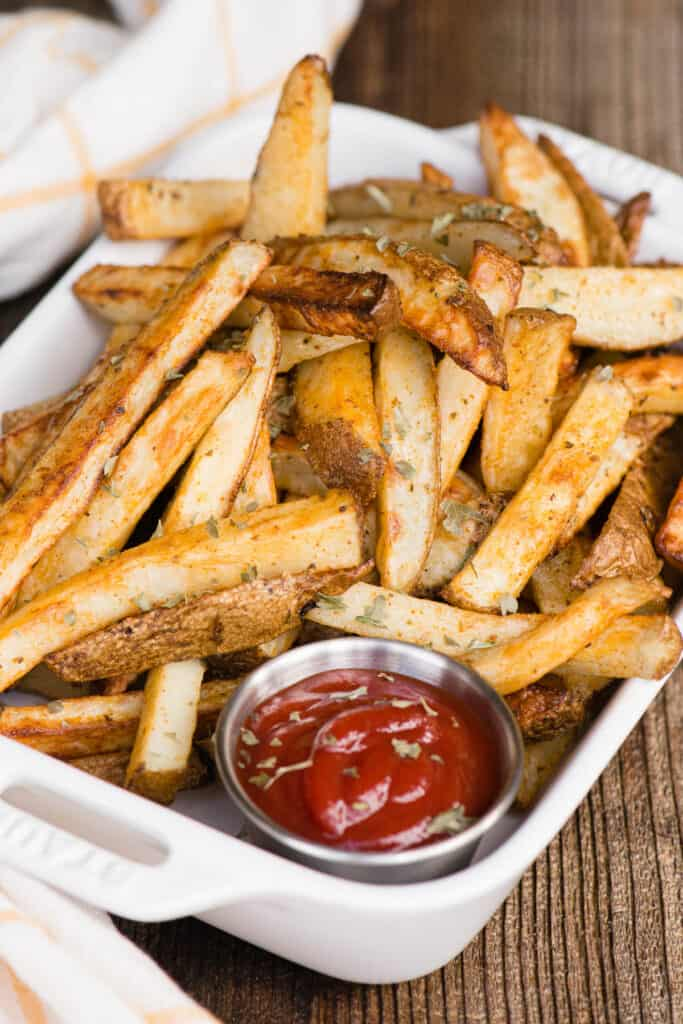 dish with french fries and ketchup