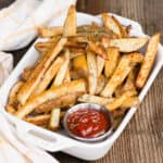 basket of fries with ketchup