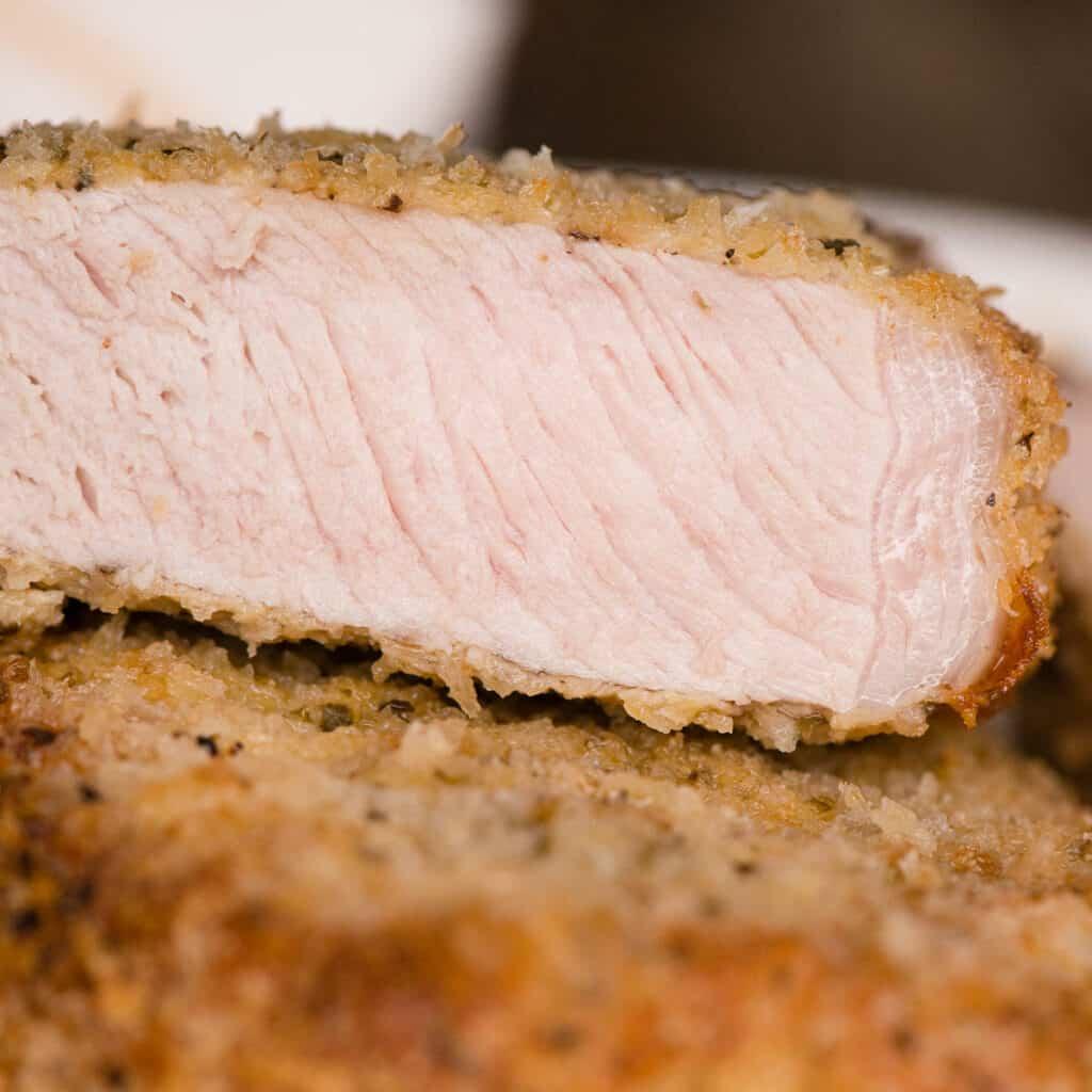 close up of a a cut breaded pork chop