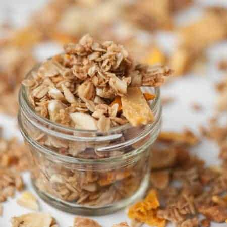 This homemade and easy to make Aloha Granola is made with delicious tropical ingredients like macadamia nuts and dried pineapple, mango, coconut and banana.
