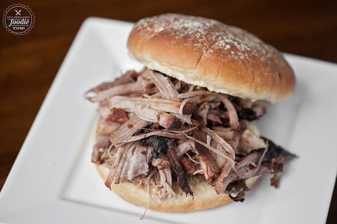 Nothing says summer like some outstanding Apple Cider Barbecue Pulled Pork. Its so tender from the brine and flavorful from the dry rub & slow cooking.