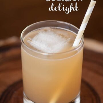 A glass of apple bourbon cocktail