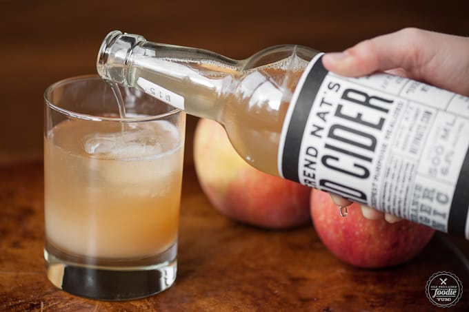 hard cider being poured into a glass