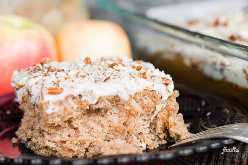 slice of homemade applesauce cake with brown butter frosting