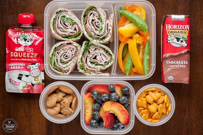 lunch with turkey pinwheels, peppers, fruit and cookies