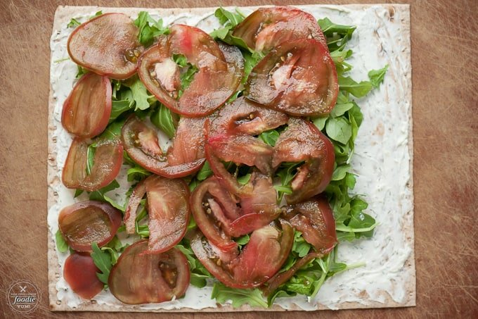 tomato, arugula, cream cheese on tortilla for roll up