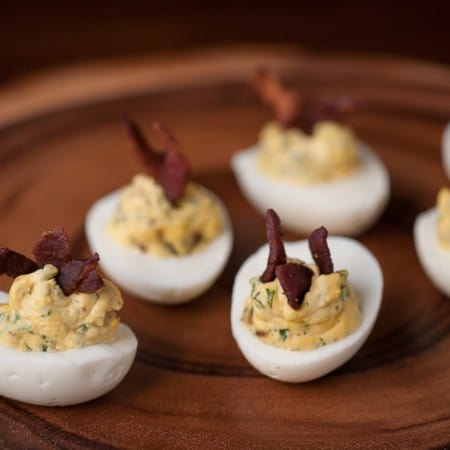 Bacon Jalapeño Deviled Eggs are a spicy two bite appetizer that people love, especially as game day grub or during a party.
