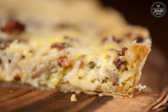 A close up of Quiche Lorraine with bacon, leeks and mushrooms