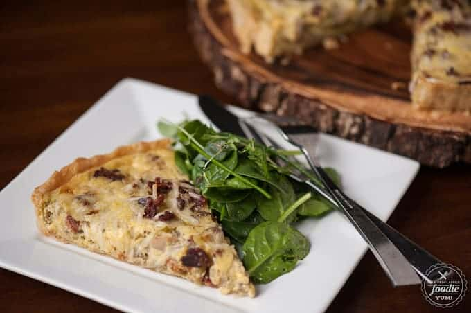 A slice of bacon Quiche Lorraine with spinach