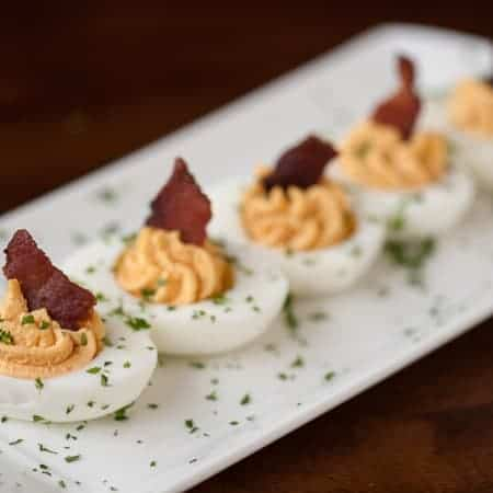 Take standard deviled eggs to the next level by making these flavorful and crowd pleasing Bacon Sriracha Deviled Eggs as your next party appetizer.