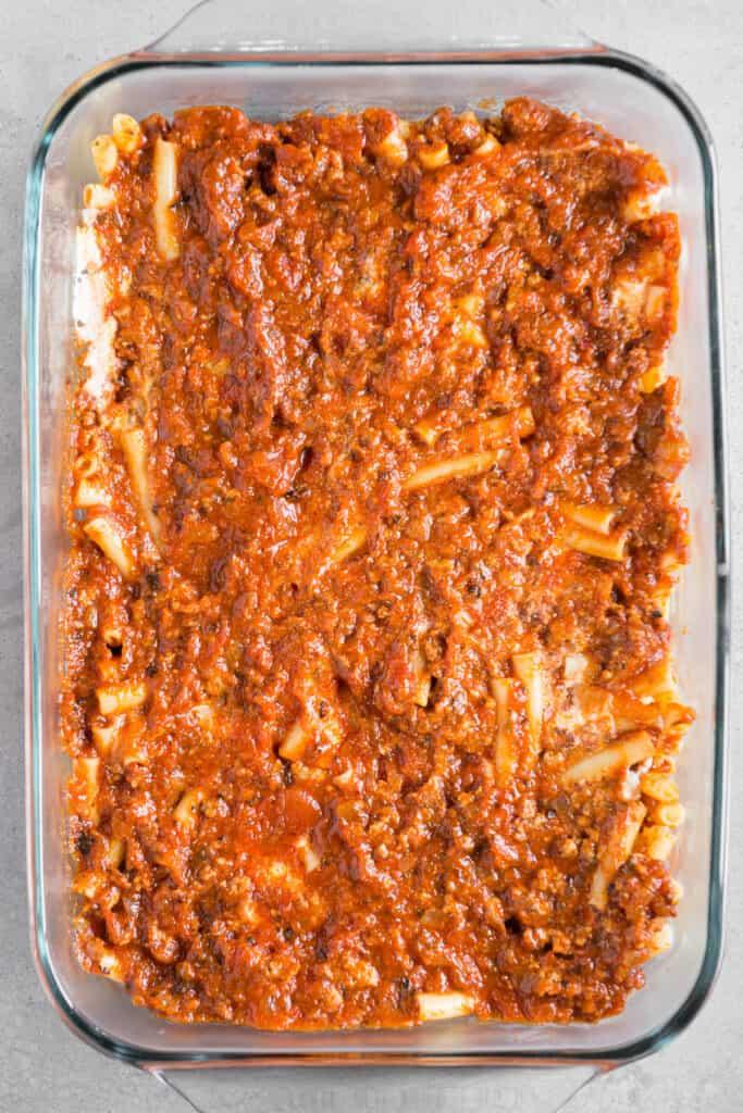 italian sausage and marinara sauce over ziti pasta