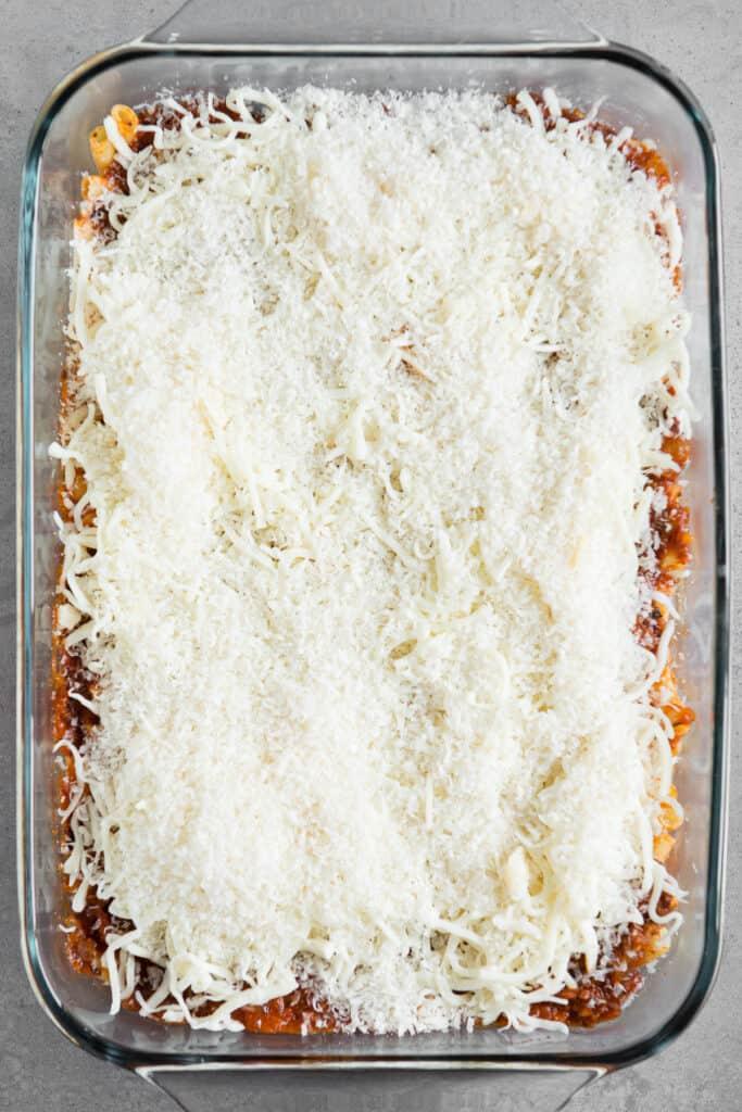 mozzarella and parmesan on pasta