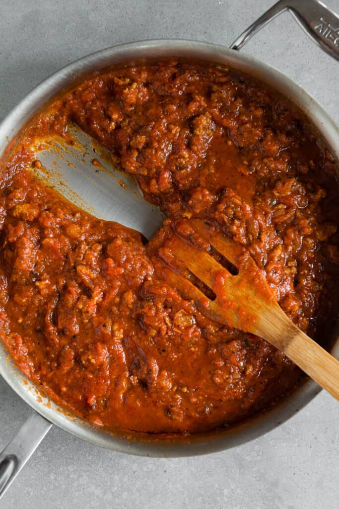 tomato sauce and sausage in pan