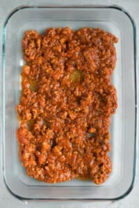 marinara sauce and italian sausage in casserole dish